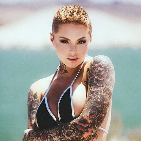 model with tattoos on the hands