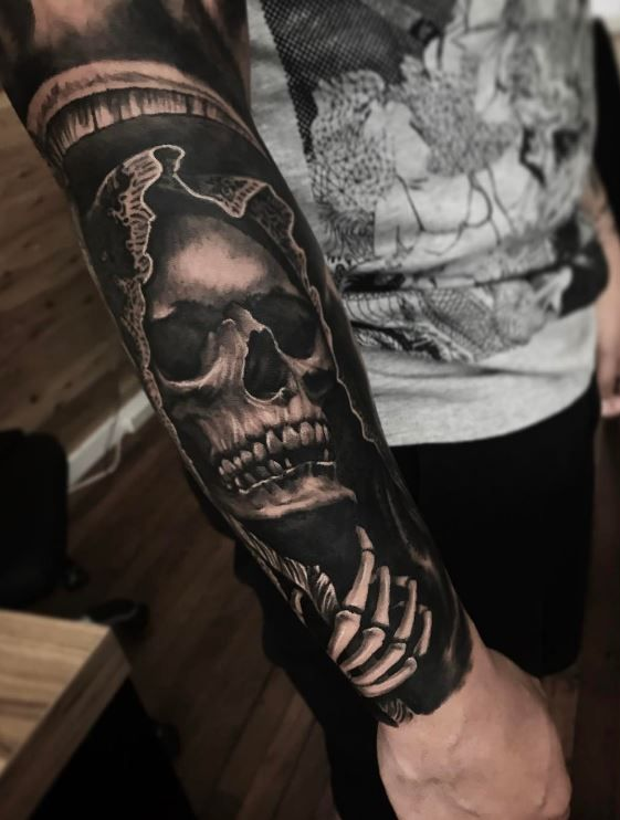 whole arm in the form of a skull with bones