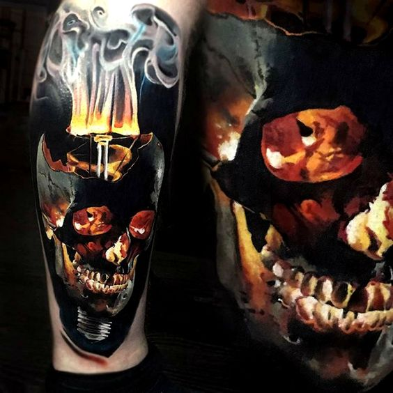 tattoo of a skull with a burning head