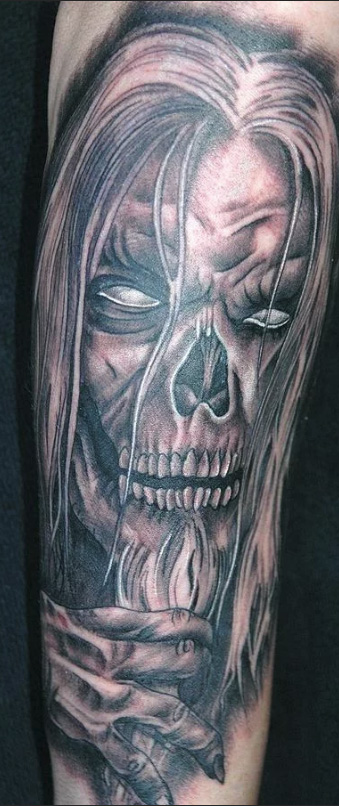 a tattoo of a skeleton
