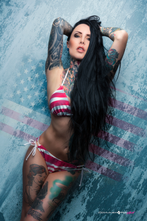 model with beautiful tattoos on the body