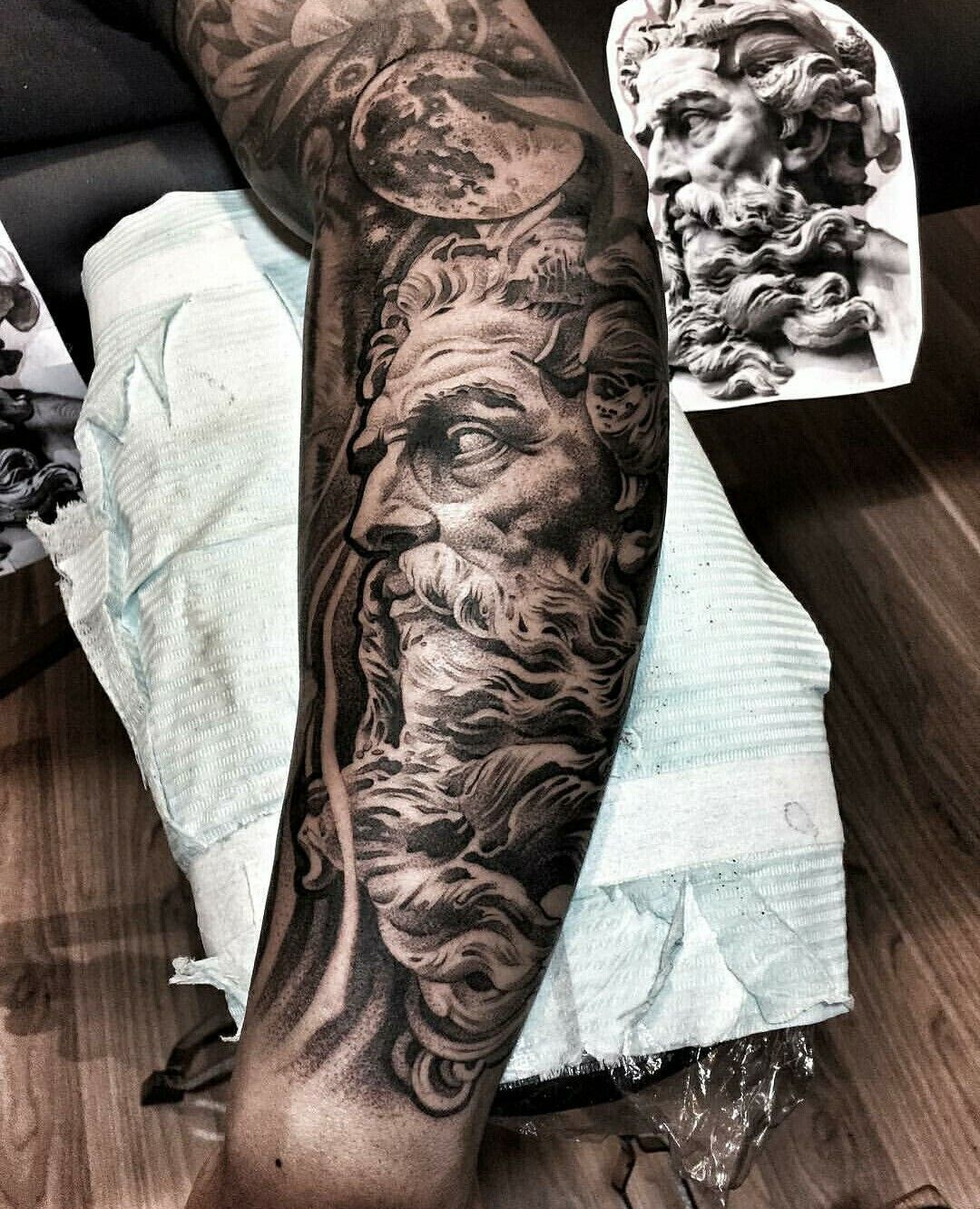 a tattoo of one of the Greek gods