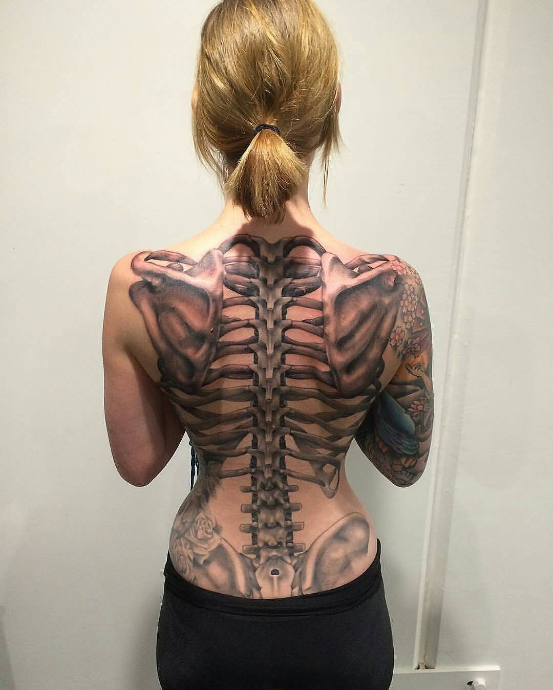 spine with a tattooed skeleton