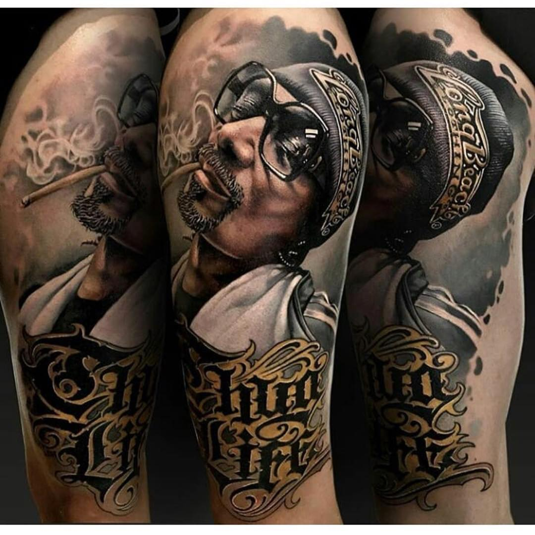 beautiful tattoo of a man with a cigar