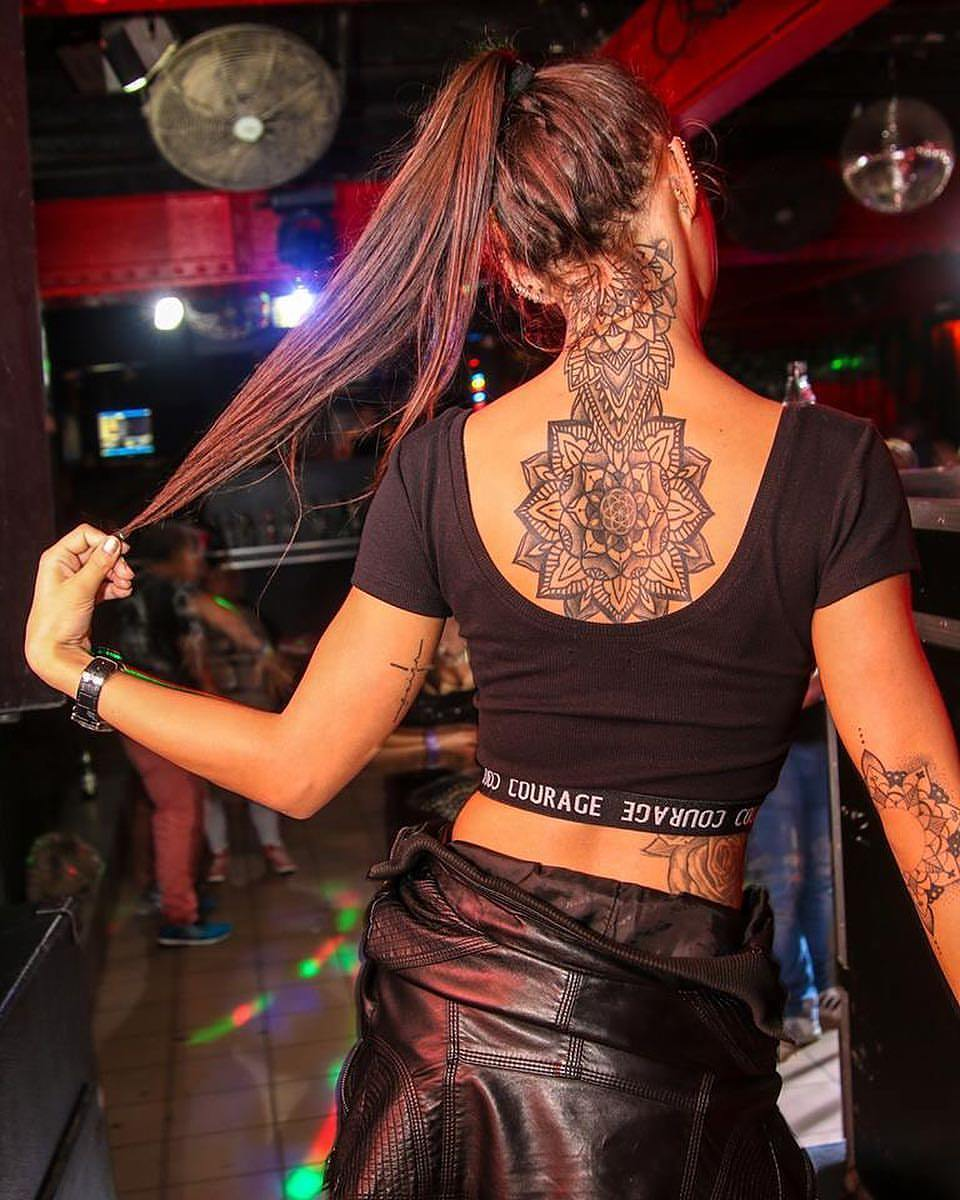 beautiful tattoo designs on the back and neck