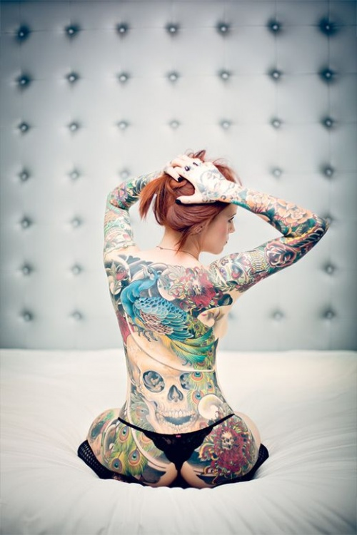 an incredible body model, in colored tattoos