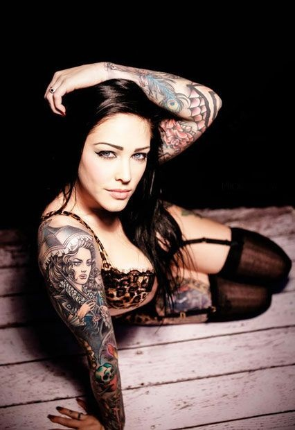 model with a tattoo on the shoulder of a girl with an umbrella