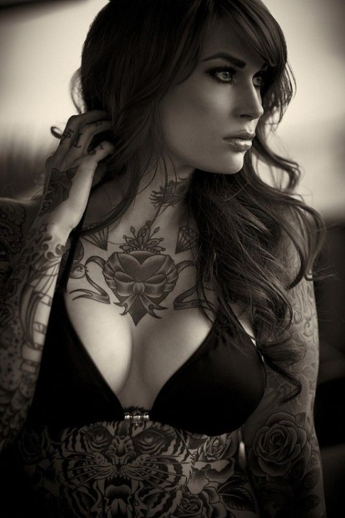 beautiful heart tattoo on the chest model