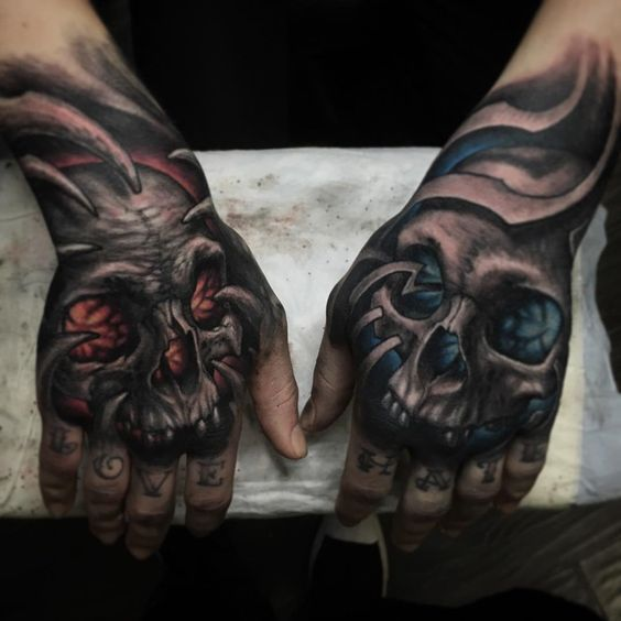 tattoo of the skull on two hands