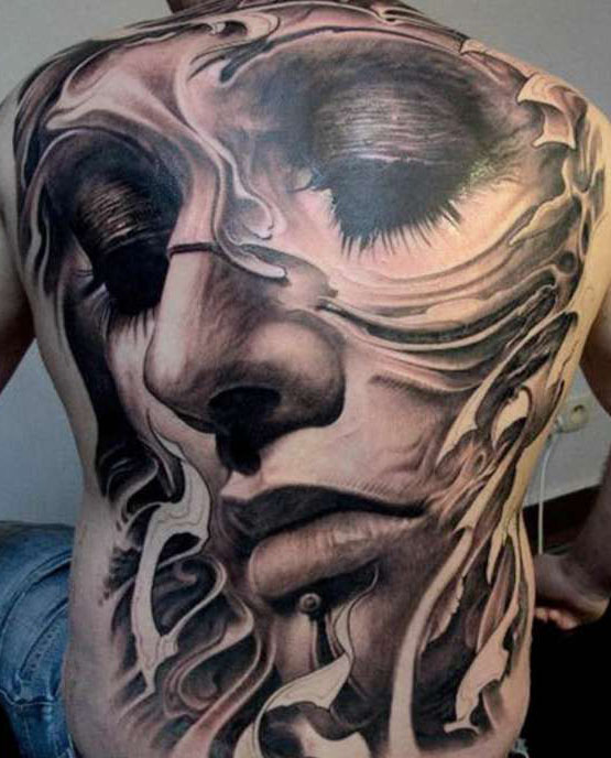 tattoo on the whole back - a girl's face,