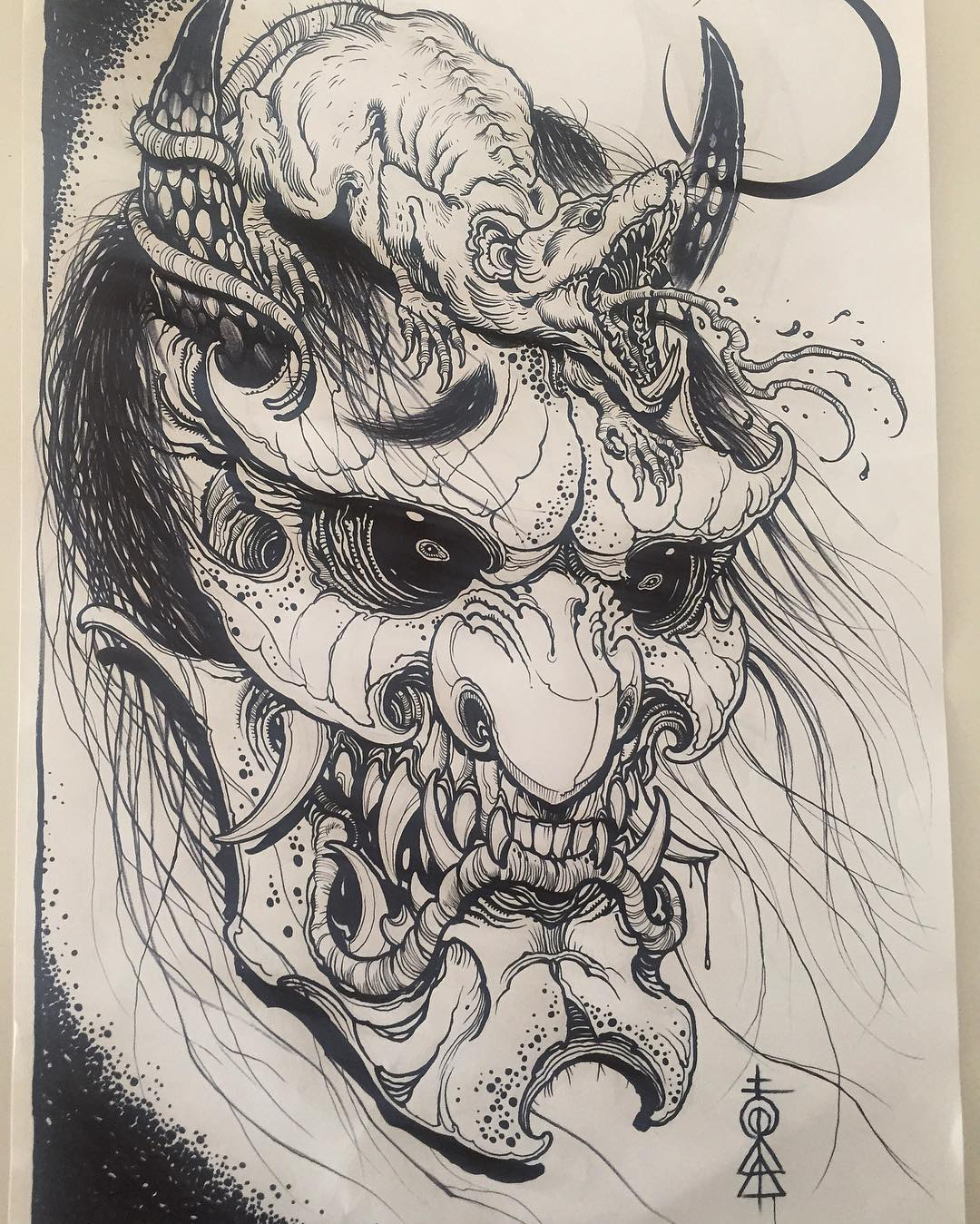 Sketches for a tattoo - a mask of a demon