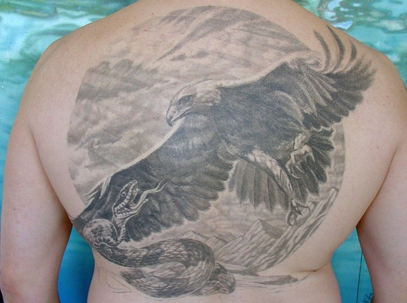 tattoo of the eagle attacking the snake