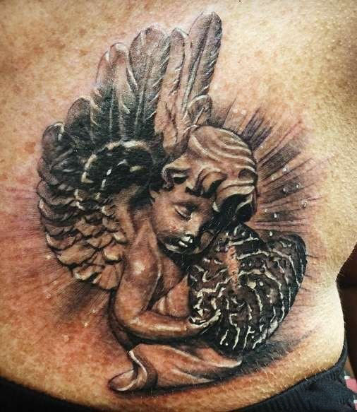 tattoo of a little angel