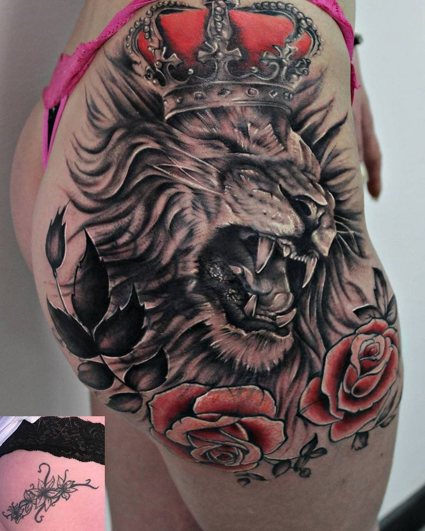 Lion tattoo on girl's thigh