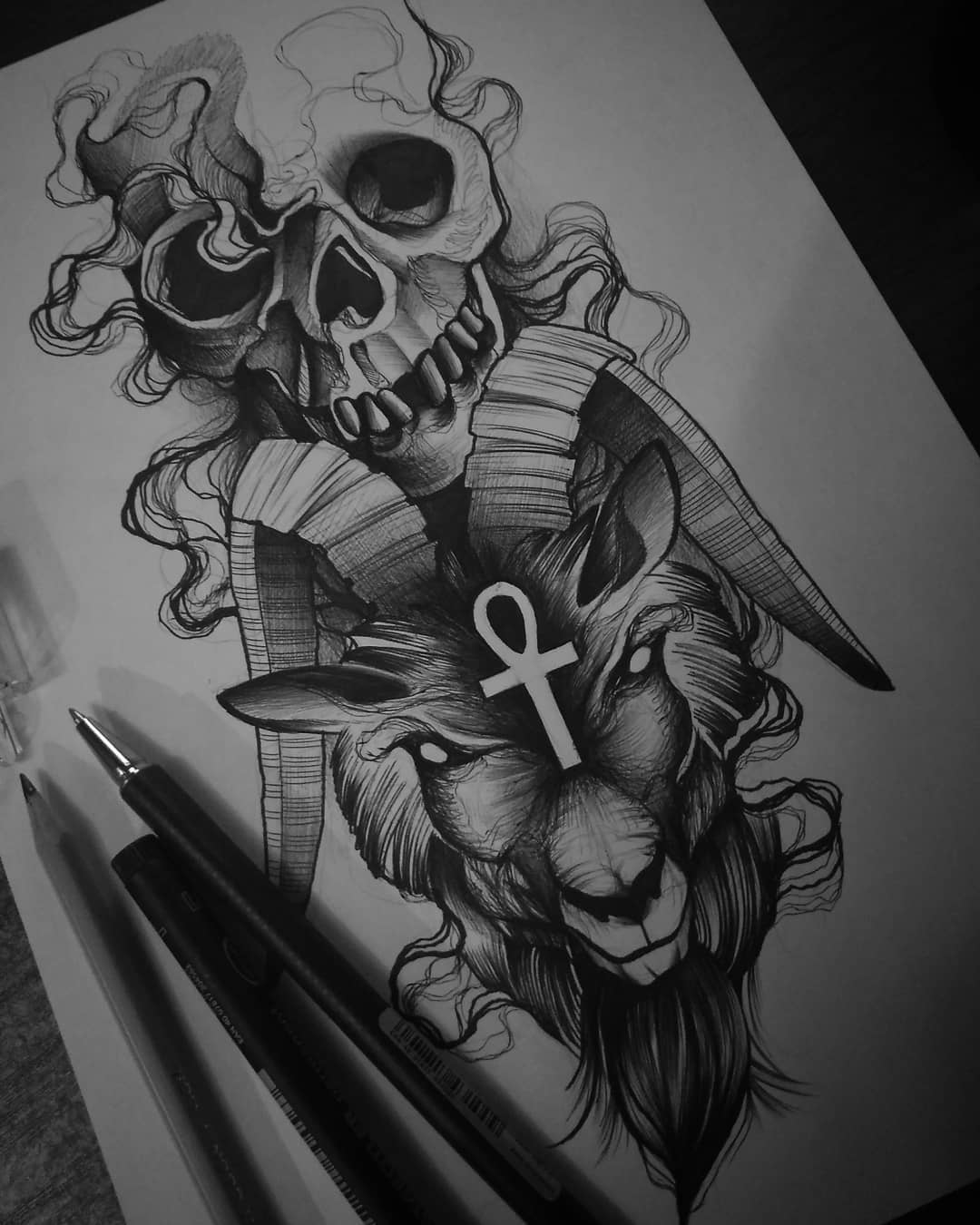 sketch for a tattoo in the form of a skull with a goat which is associated with the devil