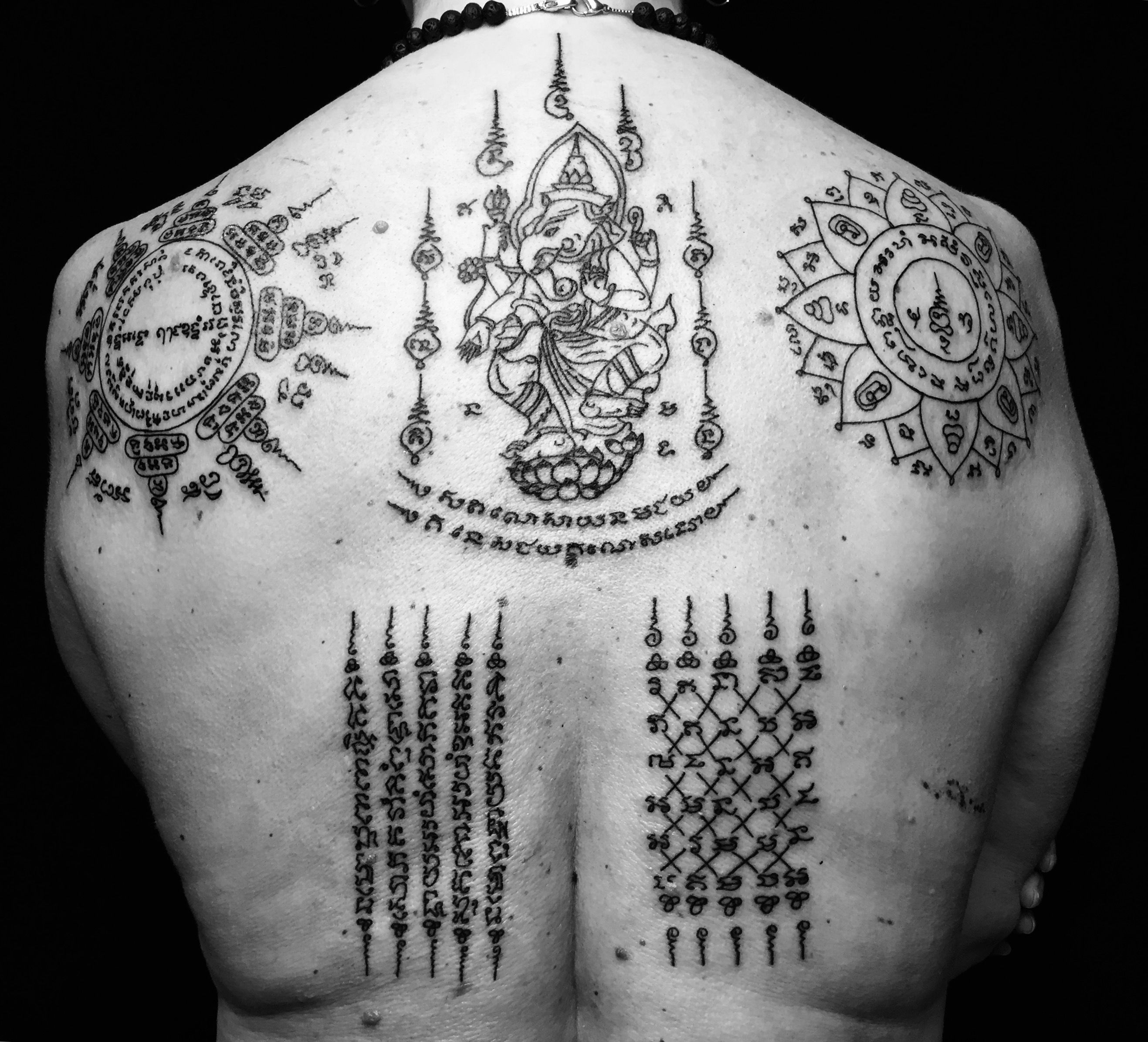 Many tattoos in the form of a Lotus, and the elephant Ganesh and protective Sak Yant
