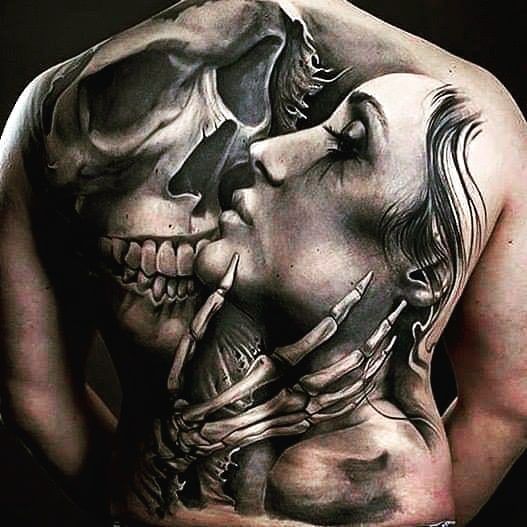 beautiful tattoo for the whole back, skull kisses a girl
