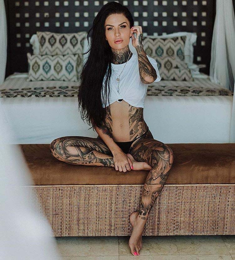 beautiful girl shows her tattoos and her athletic body