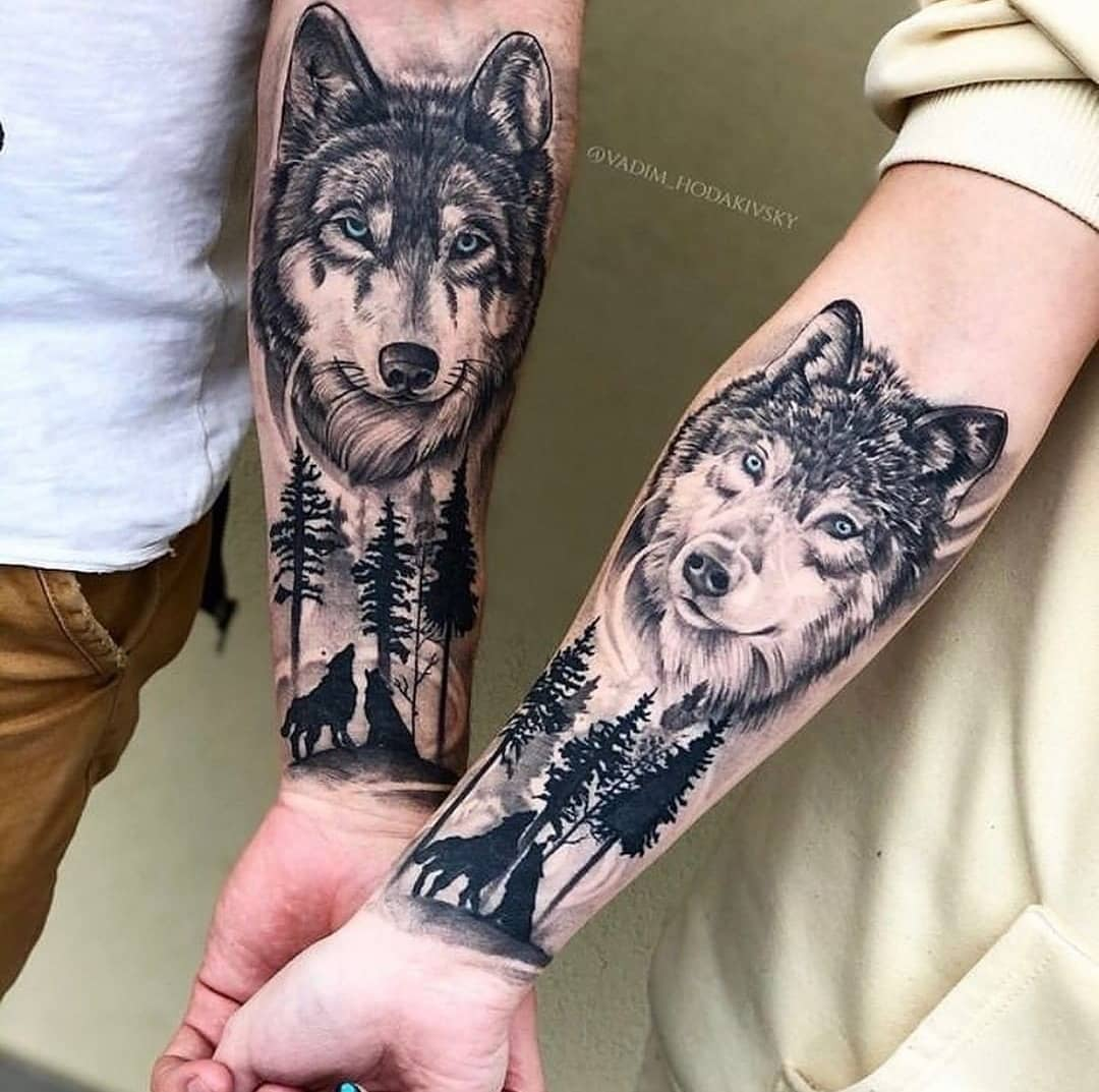 Twin tattoo of wolves on the outside of the sleeve