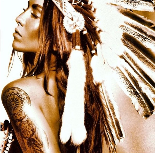 Girl with Indian chief indian feathers and dreamcatcher tattoo on a peel