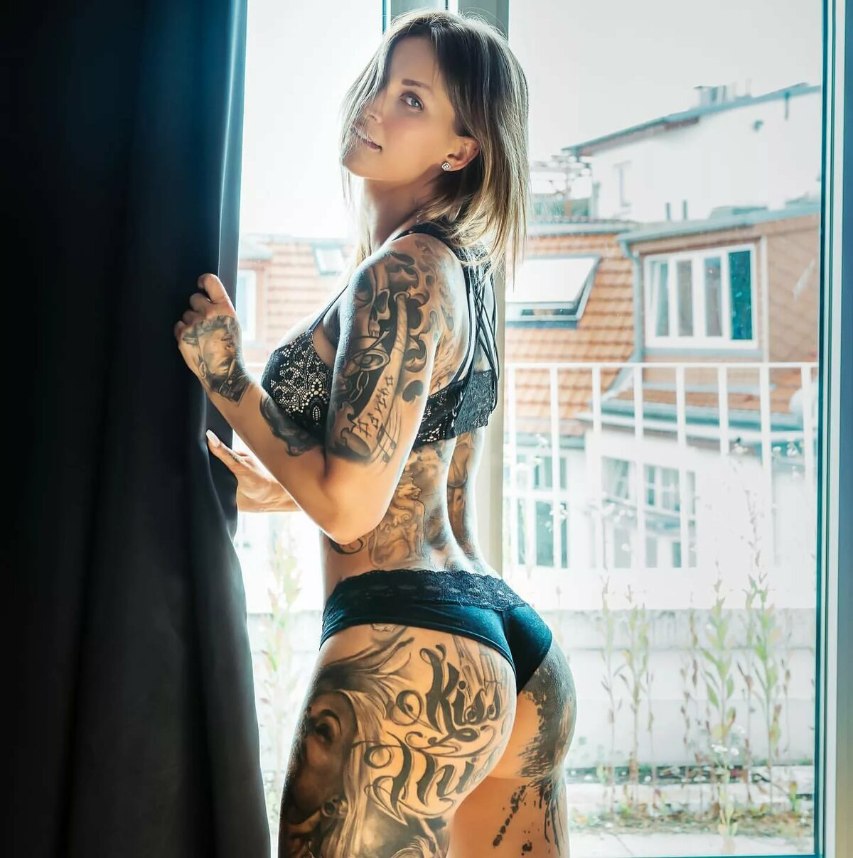 Beautiful athletic model with full body tattoos