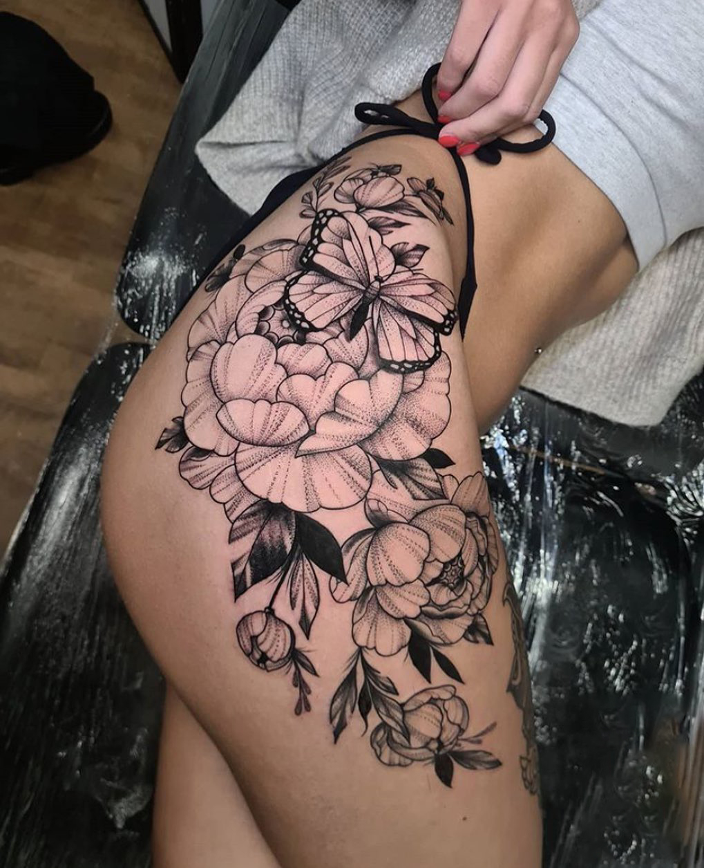 Flower And Butterfly Tattoo On Thigh