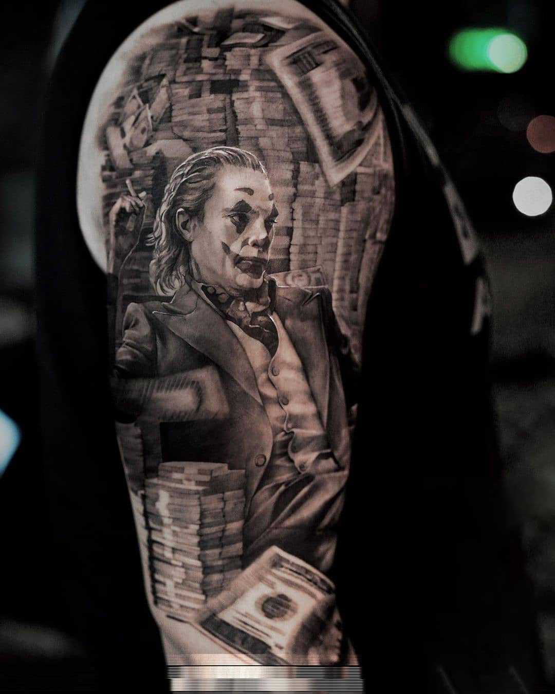 Joker - Tattoo on the arm in the style of realism
