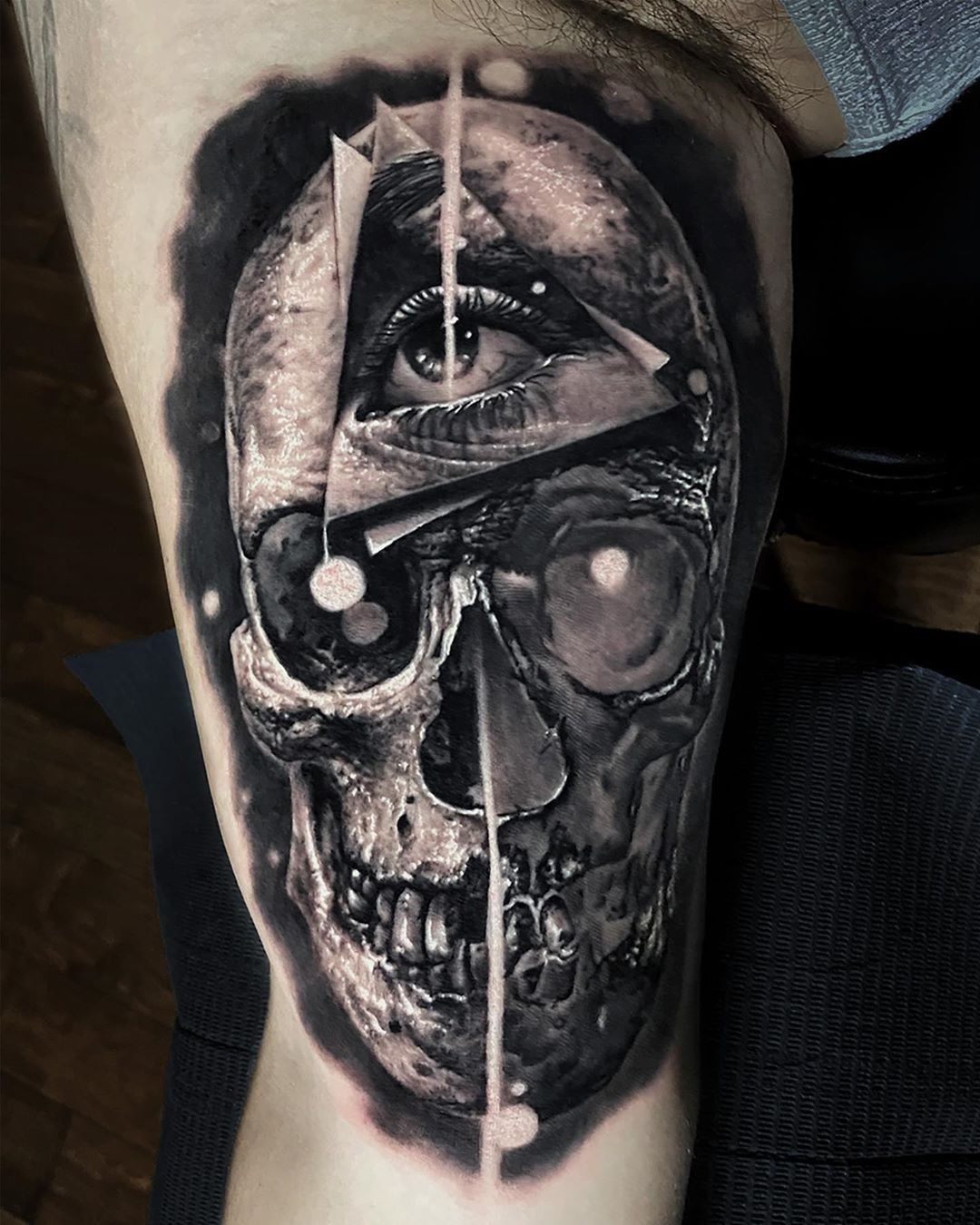 Skull tattoo on the inside of the arm