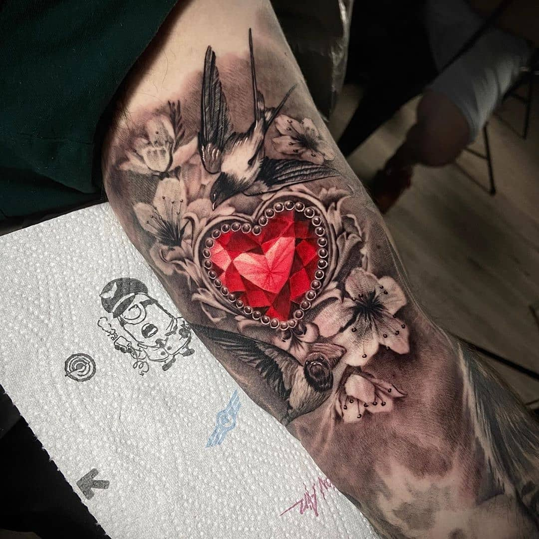 Beautiful sleeve tattoo, perfect for a girl who loves gems