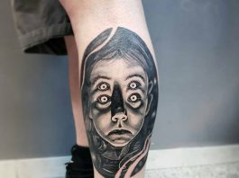 baby tattoo on the leg